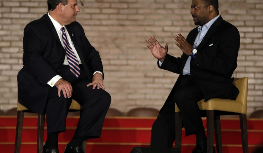 "New Jersey Gov. Chris Christie, left, talks with New Hope Baptist Church pastor Joe Carter during a summit talking about drug addiction, Tuesday, Sept. 30, 2014, in Newark, N.J. The summit, called ""The Many Faces of Addiction: Ending The Stigma,"" focused on the wide-ranging effects of drug addiction. Christie has labeled the so-called ""war on drugs"" a failure. He has called for people to put aside politics and have a frank conversation about drug addiction and incarceration. (AP Photo/Julio Cortez)"