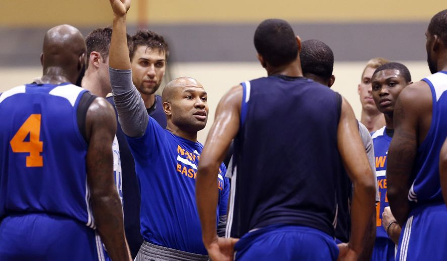 New York Knicks coach Derek Fisher talks to his players during practice at the team's NBA basketball training camp at the U.S. Military Academy on Tuesday, Sept. 30, 2014, in West Point, N.Y. (AP Photo/Mike Groll)