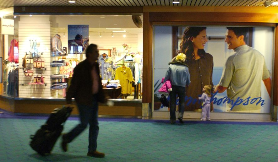 "In this 2006 photo, airport passengers pass by Norm Thompson retail outlet at Portland International Airport in Portland. The Federal Trade Commission announced this week that two companies have agreed to refund $1.5 million to consumers who purchased ""shapewear"" that supposedly can reduce cellulite and fat because it's infused with caffeine, vitamin E and other things. In a settlement, Norm Thompson Outfitters of Oregon, and Wacoal America Inc. of New Jersey agree not to make claims that their products cause weight loss or a reduction of body size. (AP Photo/The Oregonian, Dana E. Olsen)"