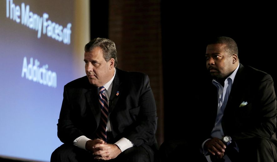 "New Jersey Gov. Chris Christie, left, and New Hope Baptist Church pastor Joe Carter listen to former drug addicts talk during a summit talking about drug addiction, Tuesday, Sept. 30, 2014, in Newark, N.J. The summit, called ""The Many Faces of Addiction: Ending The Stigma,"" focused on the wide-ranging effects of drug addiction. Christie has labeled the so-called ""war on drugs"" a failure. He has called for people to put aside politics and have a frank conversation about drug addiction and incarceration. (AP Photo/Julio Cortez)"