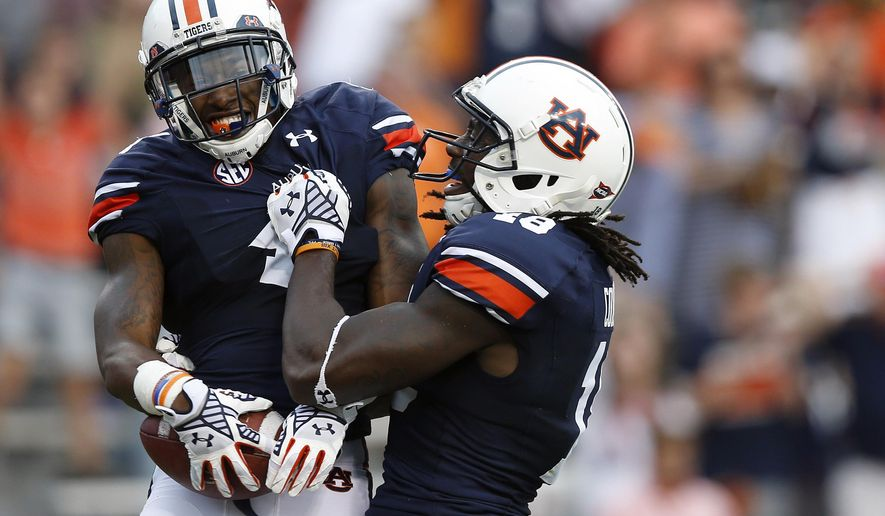Auburn wide receiver Quan Bray (4) celebrates with Auburn wide receiver Sammie Coates, right, after Bray scored a touchdown against Louisiana Tech during the second half of an NCAA college football game on Saturday, Sept. 27, 2014, in Auburn, Ala. (AP Photo/Brynn Anderson)