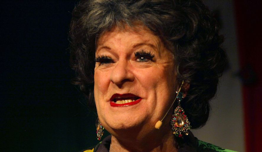 """Cross-dressing South African satirist, Pieter-Dirk Uys, speaks to journalists as Evita Bezuidenhout, at Johannesburg's Market Theatre, Tuesday Sept. 30, 2014, where he is launching a four-week run of """"Adapt or Fly"""", a one-man show in which he sends up political figures of the past and present. Uys will play signature character Evita Bezuidenhout, a flamboyant white woman from the Afrikaner minority and stalwart of the apartheid era. (AP Photo/Denis Farrell)"""