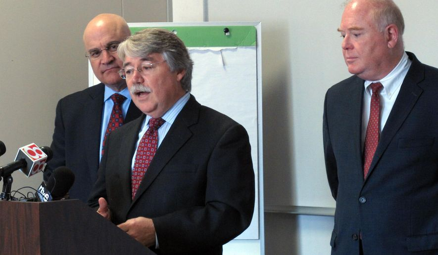 Indiana Attorney General Greg Zoeller, center, speaks during a news conference, Tuesday, Sept. 30, 2014, in Indianapolis, at which he announced that he'll support legislation that would create a state registry for home-improvement and home-repair contractors. To Zoeller's left is Tim Maniscalo, President and CEO of the Better Business Bureau of Central Indiana, and to his right is Steve Baker, Midwest Regional Director for the Federal Trade Commission. (AP Photo/Rick Callahan)