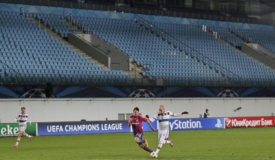 CSKA's Georgi Schennikov, center left, and Bayern's Arjen Robben, center right, vie for the ball in a stadium devoid of fans during the Group E Champions League match between CSKA Moscow and Bayern Munich at Arena Khimki stadium in Moscow, Russia, Tuesday Sept. 30, 2014. CSKA were sanctioned by governing body UEFA after the behaviour of their fans during group stage matches against Manchester City and Czech club Viktoria Plzen last season. (AP Photo/Pavel Golovkin)