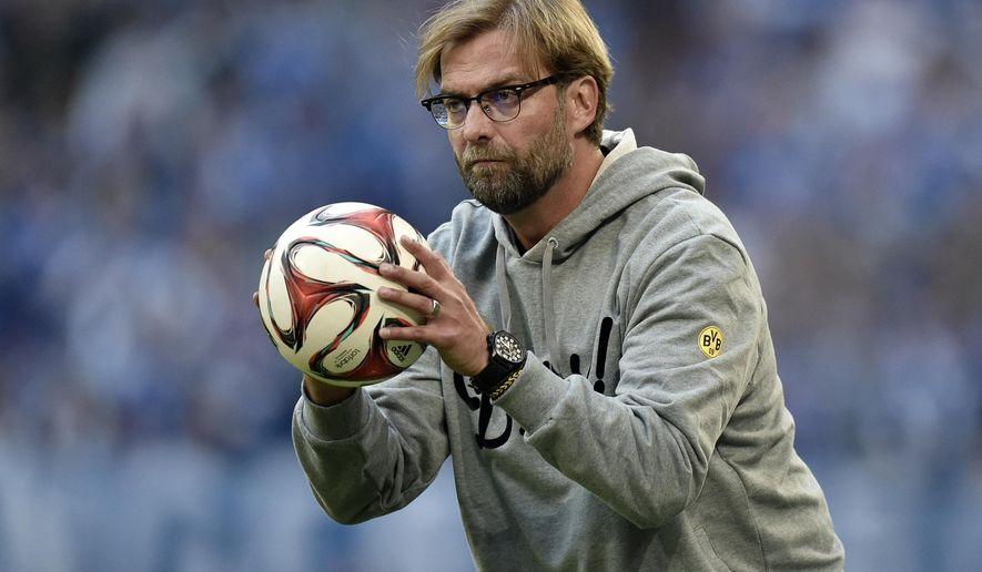 Dortmund's head coach Juergen Klopp catches a ball during the German Bundesliga soccer match between FC Schalke 04 and Borussia Dortmund in Gelsenkirchen, Germany, Saturday, Sept. 27, 2014. Schalke won the derby with 2-1. (AP Photo/Martin Meissner)