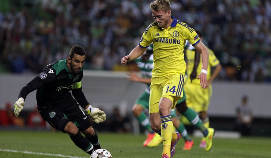 Chelsea's Andre Schuerrle, right, takes on Sporting's goalkeeper Rui Patricio during a Champions League, Group G soccer match between Sporting and Chelsea, in Lisbon, Tuesday, Sept. 30, 2014. (AP Photo/Francisco Seco)