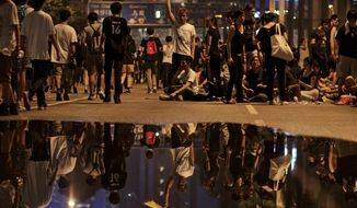 Pro-democracy student protesters occupy a main thoroughfare in Hong Kong after Chief Executive Leung Chun-ying refused to meet with demonstrators before their deadline. Tens of thousands of protesters have taken to the streets in the stiffest challenge to Beijing's authority since China took control of the former British colony in 1997. (Associated Press)
