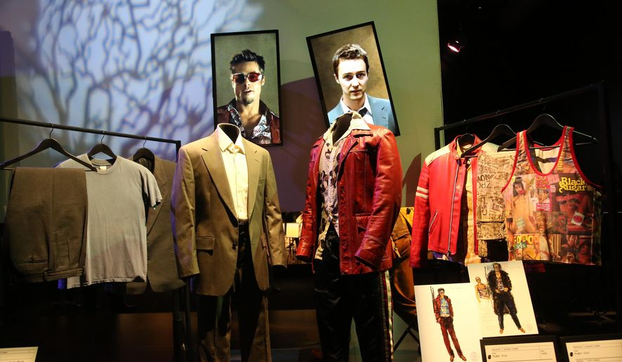 "Costumes from the film, ""Fight Club,"" worn by Brad Pitt and Edward Norton are on display at the press preview of the ""Hollywood Costume"" exhibition Monday, Sept. 29, 2014, in Los Angeles. The exhibit which includes iconic costumes from the Golden Age of cinema to the present opens Thursday inside the historic Wilshire May Company building in Los Angeles, which is set to reopen as the Academy Museum of Motion Pictures in 2017. The exhibit is on view through March 2, 2015. (AP Photo/Nick Ut)"