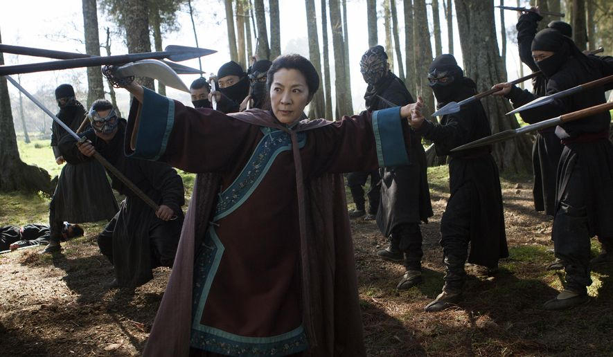 "In this image released by Netflix, Michelle Yeoh appears in a scene from""Crouching Tiger, Hidden Dragon: The Green Legend,"" which will premiere on Netflix and in selected global IMAX theaters on Aug. 28, 2015. (AP Photo/Netflix, Rico Torres)"