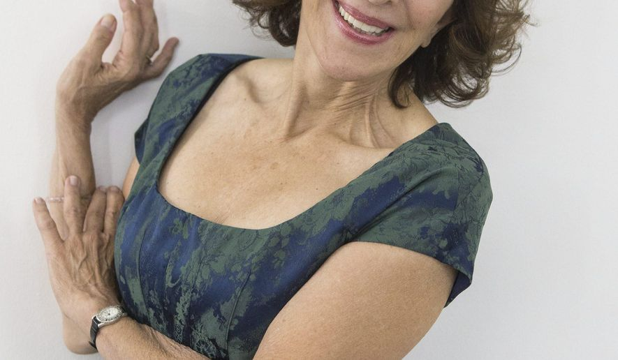 """In this Sept. 22, 2014 file photo, comedian and actress Andrea Martin poses in Toronto as she promotes her new book """"Lady Parts."""" In her book, Martin, 67, talks about being on """"SCTV"""" alongside the likes of Eugene Levy, John Candy and Catherine O'Hara, and what it was like to be in """"Pippin"""" on Broadway. (AP Photo/The Canadian Press, Chris Young, File)"""