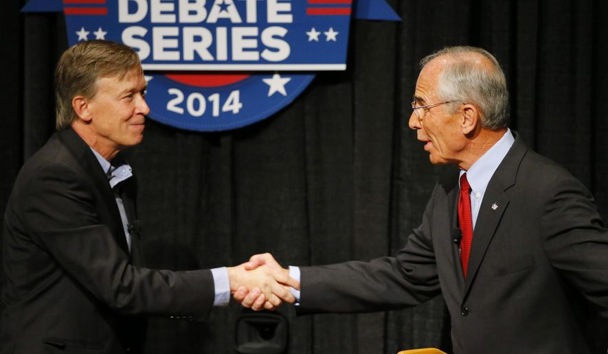 Democratic Gov. John Hickenlooper, left, and Republican candidate Bob Beauprez greet during a gubernatorial debate Tuesday, Sept. 30, 2014, in Denver. The debate provided an opportunity for the candidates to try to take the lead in a race that polls have shown to be tied. (AP Photo/Jack Dempsey)