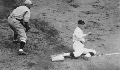In this Oct. 5, 1924, photo made available by the Library of Congress Senators Joe Judge is safe at 3rd in the 9th inning of the 7th game of the World Series in Washington between the Washington Senators and the New York Giants.  (AP Photo/Library of Congress)