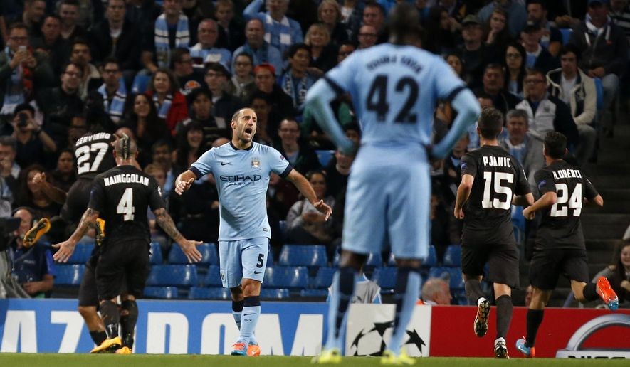Manchester City's Pablo Zabaleta (5) reacts as Roma players celebrate the goal of Francesco Totti during a Champions League group E soccer match between Manchester City and Roma at the Etihad Stadium, Manchester, England, Tuesday, Sept. 30, 2014. (AP Photo/Jon Super)