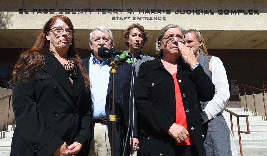 The families of two murder victims, David Dunlap and Whitney Dunlap, spoke to the media outside the El Paso County Terry R. Harris Judicial Complex in Colorado Springs, Colo., Tuesday, Sept. 30, 2014. Macyo January is charged as an adult with first-degree murder although he was 17 at the time Staff Sgt. David and Whitney were killed in 2013 during a burglary. (AP Photo/The Colorado Springs Gazette, Jerilee Bennett)