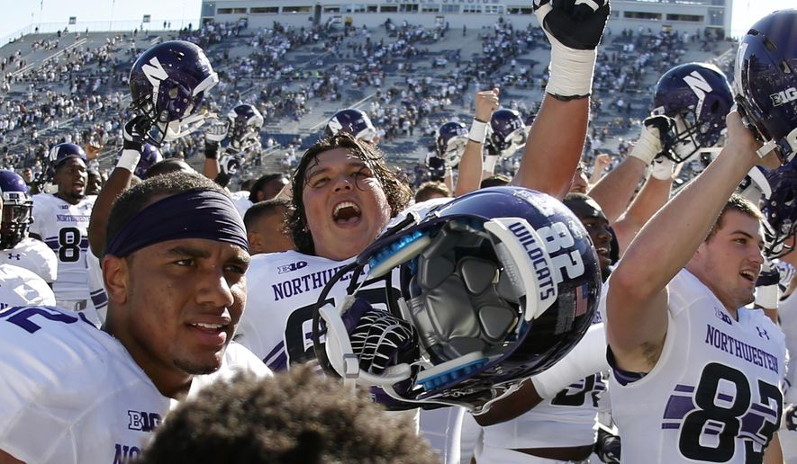Northwestern players celebrate with after beating Penn State 29-6 in an NCAA college football game in State College, Pa., Saturday, Sept. 27, 2014. (AP Photo/Gene J. Puskar)