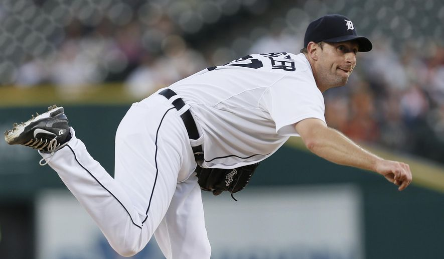Detroit Tigers pitcher Max Scherzer throws against the Minnesota Twins in the first inning of a baseball game in Detroit, Thursday, Sept. 25, 2014. (AP Photo/Paul Sancya)