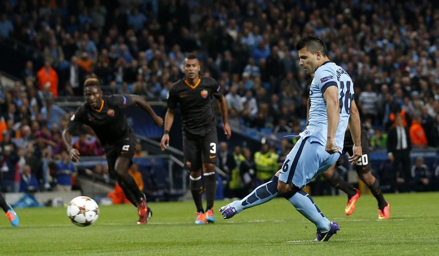 Manchester City's Sergio Aguero scores a penalty during a Champions League group E soccer match between Manchester City and Roma at the Etihad Stadium, Manchester, England, Tuesday, Sept. 30, 2014. (AP Photo/Jon Super)