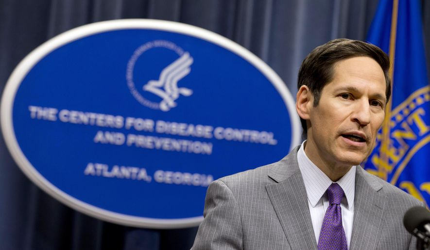 Director of Centers for Disease Control and Prevention Dr. Tom Frieden speaks during a news conference after confirming that a patient at Texas Health Presbyterian Hospital has tested positive for Ebola, the first case of the disease to be diagnosed in the United States, announced Tuesday, Sept. 30, 2014, in Atlanta. The person, an adult who was not publicly identified, developed symptoms days after returning to Texas from Liberia and showed no symptoms on the plane, according to the Centers for Disease Control and Prevention. (AP Photo/John Bazemore)