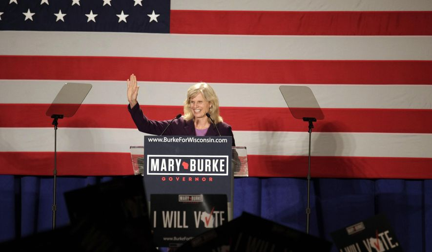 Wisconsin Democratic gubernatorial candidate Mary Burke speaks to supporters at a campaign rally Monday, Sept. 29, 2014, in Milwaukee. (AP Photo/Darren Hauck)