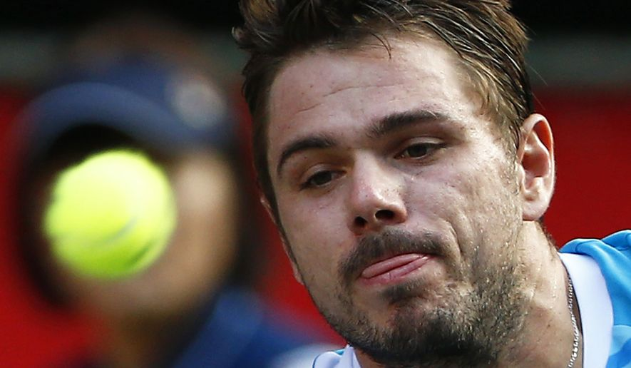 Stanislas Wawrinka of Switzerland watches the ball while playing against Tatsuma Ito of Japan during their first round match of Japan Open Tennis Championships in Tokyo, Tuesday, Sept. 30, 2014. (AP Photo/Shizuo Kambayashi)