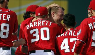Washington Nationals starting pitcher Jordan Zimmermann, fourth from left, celebrates with his teammates after he threw a no-hitter in a baseball game against the Miami Marlins at Nationals Park, Sunday, Sept. 28, 2014, in Washington. The Nationals won 1-0. (AP Photo/Alex Brandon)