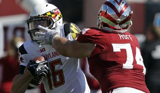 Maryland's C.J. Brown (16) is sacked by Indiana's Nate Hoff (74)  during the first half of an NCAA college football game Saturday, Sept. 27, 2014, in Bloomington, Ind. (AP Photo/Darron Cummings)