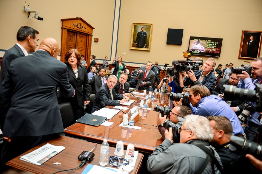 Chairman Darrell Issa (R-Cal.), left, and Ranking Member Elijah Cummings (D-Md.), second from left, greet Secret Service Director Julia Pierson, third from left, before she testifies in front of the House Oversight and Government Reform Committee on Capitol Hill to discuss the recent White House perimeter breach when an armed Texas man made it into the White House earlier this month, Washington, D.C., Tuesday, September 30, 2014. (Andrew Harnik/The Washington Times)
