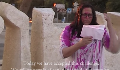 The group Jews Against Genocide posted a video in which the activists are shown pouring fake blood over their heads at Israel's national Holocaust memorial Yad Vashem in Jerusalem, the U.S. Embassy in Tel Aviv, Israel's High Court of Justice and the Knesset. (YouTube)