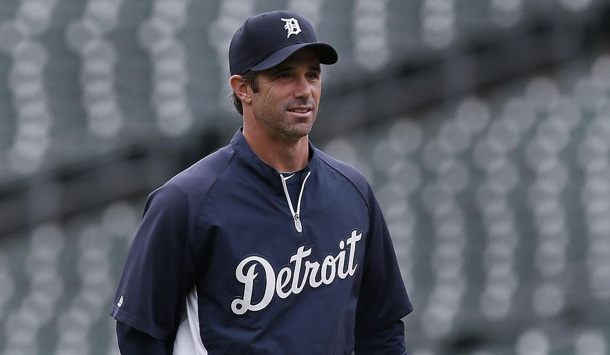 Detroit Tigers manager Brad Ausmus watches during baseball practice in Detroit Tuesday, Sept. 30, 2014. The Detroit Tigers start the playoffs at the Baltimore Orioles in Game 1 of the American League Division Series Thursday. (AP Photo/Paul Sancya)