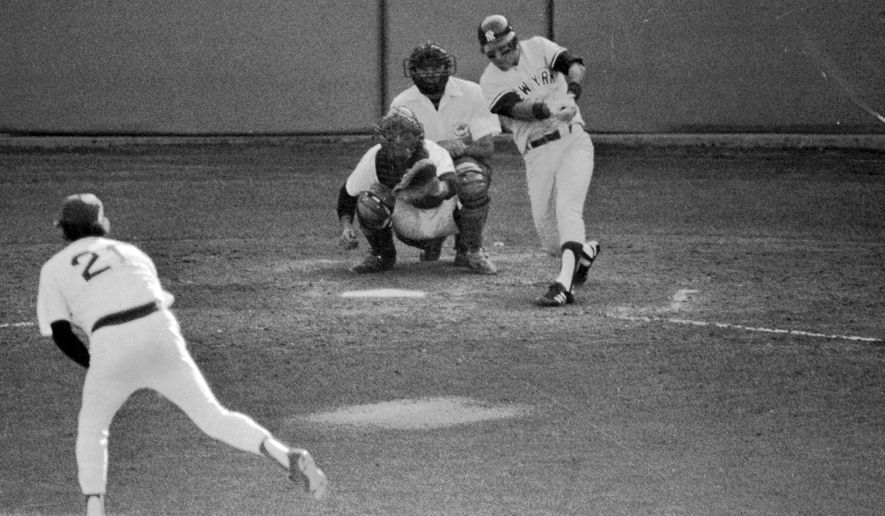 FILE - In this Oct. 2, 1978, file photo, New York Yankees' Bucky Dent hits a three-run home run against the Boston Red Sox during the seventh inning of a baseball game for the American League East title in Boston. Baseball has had a history of one-game playoffs dating to Cleveland's 8-3 victory over Boston at Fenway Park to win the 1948 American League pennant.  (AP Photo/Ray Stubblebine, File)