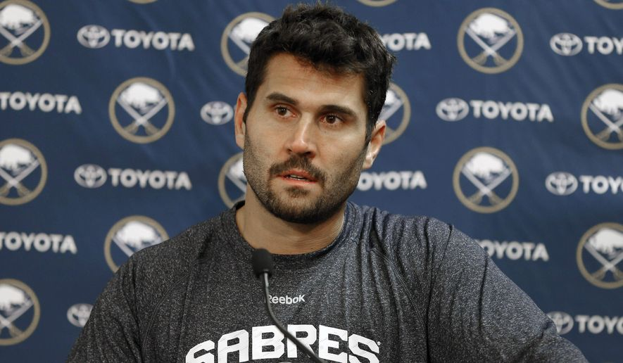 FILE - In this Sept. 18, 2014, file photo, Buffalo Sabres forward Brian Gionta addresses the media on opening day of NHL training camp in Buffalo, N.Y. With the NHL right in the heart of its small preseason slate, a long list of accomplished forwards in different zip codes are getting used to their new lines. (AP Photo/The Buffalo News, Derek Gee) TV OUT; MAGS OUT; MANDATORY CREDIT; BATAVIA DAILY NEWS OUT; DUNKIRK OBSERVER OUT; JAMESTOWN POST-JOURNAL OUT; LOCKPORT UNION-SUN JOURNAL OUT; NIAGARA GAZETTE OUT; OLEAN TIMES-HERALD OUT; SALAMANCA PRESS OUT; TONAWANDA NEWS OUT