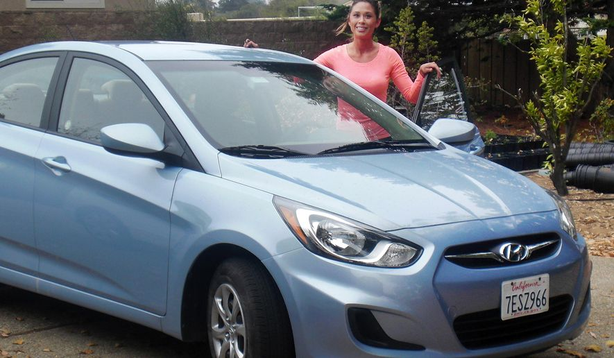 This undated photo provided by the Nye County Sheriff shows Los Osos, Calif. resident Margay Edwards, 27, with her 2014 Hyundai Accent. Edwards was found dead on Sept. 25, 2014 near a dirt track outside Pahrump, Nev. Deputies have called the death suspicious and are still looking for Edwards cellphone and blue 2014 Hyundai Accent. (AP Photo/Nye County Sheriff)