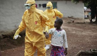 Nowa Paye, 9, is taken to an ambulance after showing signs of the Ebola infection in the village of Freeman Reserve, about 30 miles north of Monrovia, Liberia,Tuesday Sept. 30, 2014. Three members of District 13 ambulance service traveled to the village to pickup six suspected Ebola sufferers that had been quarantined by villagers. Aid donations are still inadequate, as the international community tries to increase the ability to care for the spiraling number of people infected with the disease which has hit Liberia the hardest. (AP Photo/Jerome Delay)
