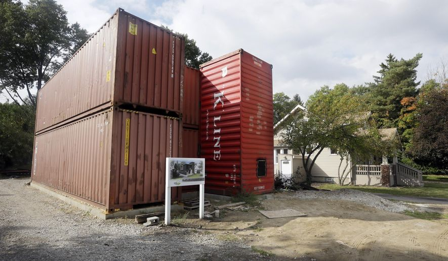 A home built of commercial shipping containers is under construction in Royal Oak, Mich., Wednesday, Oct. 1, 2014. Seven shipping containers will be transformed to make up the 2,100 square-foot home, which includes three bedrooms and 2.5 bathrooms. Holes for windows and passageways will be cut before plumbing, electrical wiring and other mechanical functions are installed. (AP Photo/Carlos Osorio)