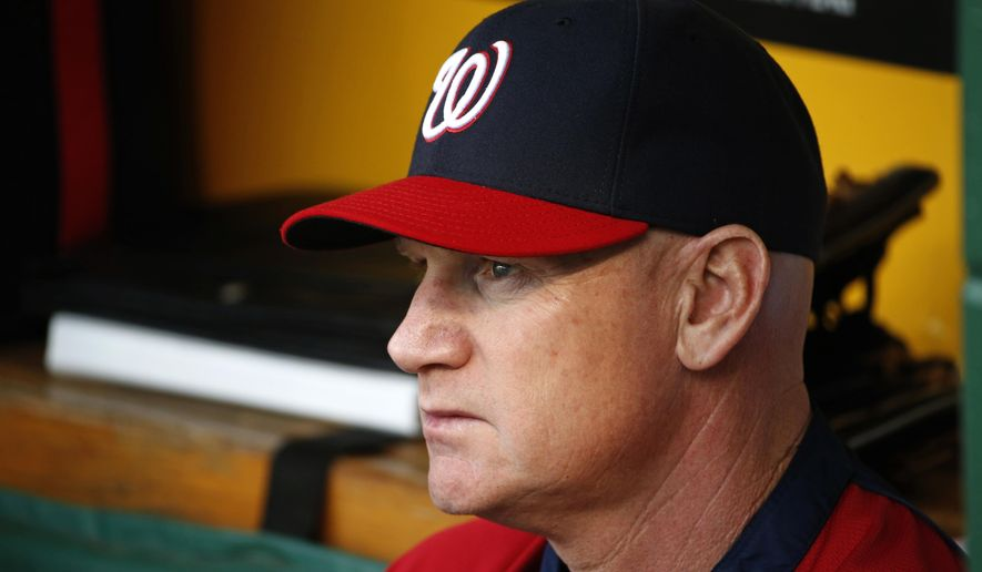 FILE - In this May 22, 2014 file photo, Washington Nationals manager Matt Williams sits in the dugout before a baseball game against the Pittsburgh Pirates in Pittsburgh. Williams was in his 18th game as a major league manager, still learning on the job with the Washington Nationals, when he went with his gut. Williams saw Bryce Harper hit a comebacker, jog out of the batter's box and veer off toward the dugout several strides before reaching first base. Williams, seething, yanked Harper from the lineup. That decision in April was one of thousands on the way to an NL East title as a rookie skipper that made clear, if there were any doubts, the 48-year-old Williams would do things his way. (AP Photo/Gene J. Puskar, File)