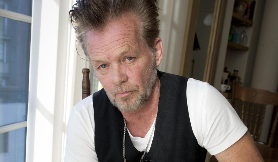 "FILE - In this Sept. 22, 2014 file photo, singer-songwriter John Mellencamp poses for a portrait to promote his 22nd album ""Plain Spoken"" at the Greenwich Hotel in New York. (Photo by Amy Sussman/Invision/AP, File)"
