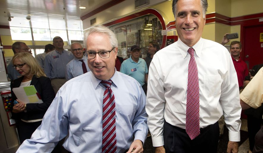 Former GOP presidential candidate Mitt Romney, right, and Attorney General Sam Olens arrive at the Varsity, Wednesday, Oct. 1, 2014, in Atlanta. Romney endorsed Olens' reelection and attended a private fund raiser for Republican candidate for Senate David Perdue earlier. (AP Photo/John Bazemore)
