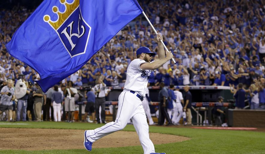 FILE - In this Sept. 30, 2014, file photo, Kansas City Royals' Greg Holland celebrates after the Royals' 9-8 victory over the Oakland Athletics in 12 innings in the AL wild-card playoff baseball game in Kansas City, Mo. Baseball has had a history of one-game playoffs dating to Cleveland's 8-3 victory over Boston at Fenway Park to win the 1948 American League pennant. (AP Photo/Jeff Roberson, File)