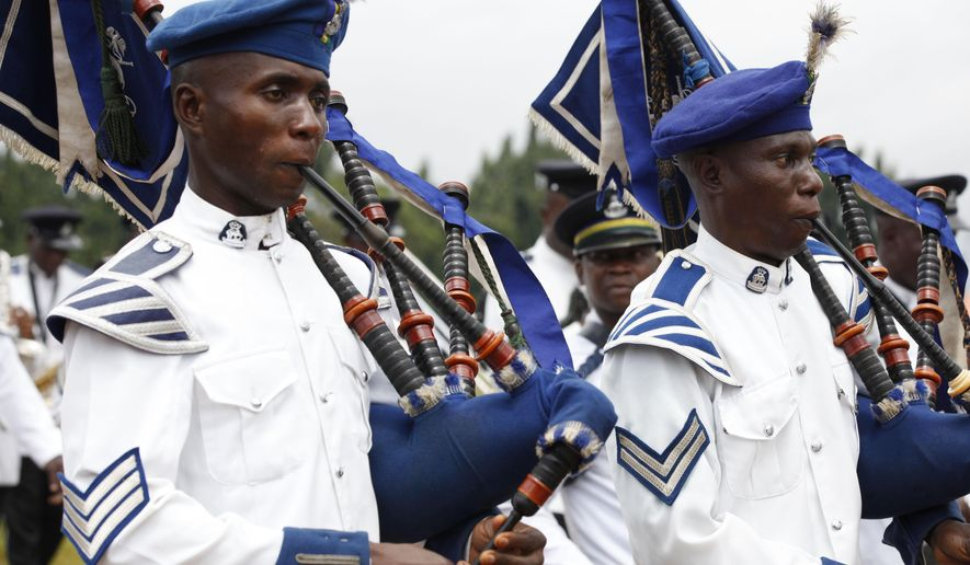 The Nigerian police band march during the 54th anniversary celebrations of Nigerian independence, in Lagos, Nigeria, Wednesday, Oct. 1, 2014. (AP Photo/Sunday Alamba)