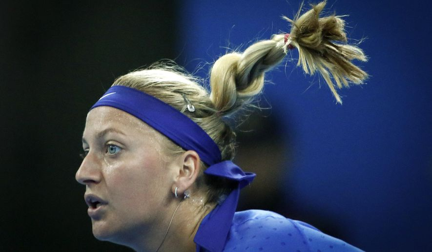 Petra Kvitova of the Czech Republic returns a shot from Peng Shuai of China during the China Open tennis tournament at the National Tennis Stadium in Beijing, China, Wednesday, Oct. 1, 2014. (AP Photo/Vincent Thian)