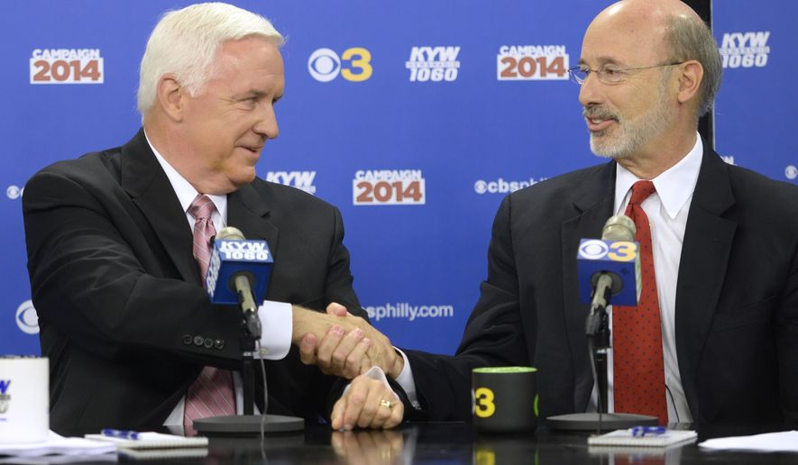 """Republican Gov. Tom Corbett, left, and Democratic challenger Tom Wolf shake hands following their debate at """"Breakfast with the Candidates"""" event at KYW-TV and KYW-AM  on Wednesday, Oct. 1, 2014 in Philadelphia. The second debate between the two became tense as Wolf sought to assign blame to Corbett for budget deficits and struggling schools while Corbett tried to frame Wolf as the candidate who will favor labor unions over taxpayers.  (AP Photo/The Philadelphia Inquirer, Tom Gralish, Pool)"""