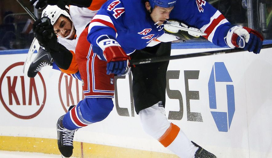10ThingstoSeeSports - Philadelphia Flyers' Zac Rinaldo, left, and New York Rangers' Matt Hunwick (44) collide during the first period of an NHL preseason hockey game Monday, Sept. 29, 2014, in New York. (AP Photo/Jason DeCrow, File)