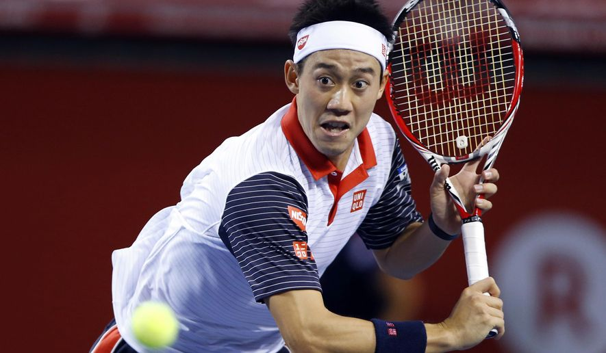Kei Nishikori of Japan watches the ball while playing against Ivan Dodig of Croatia during their first round match of Japan Open Tennis Championships in Tokyo, Wednesday, Oct. 1, 2014. (AP Photo/Shizuo Kambayashi)
