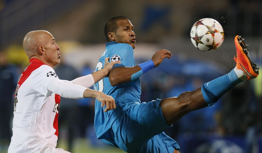 Monaco's Andrea Raggi, left, and Zenit's Jose Rondon struggle for the ball during the Champions League Group C soccer match between Zenit and Monaco at Petrovsky stadium in St.Petersburg, Russia, Wednesday Oct. 1, 2014. (AP Photo/Dmitry Lovetsky)