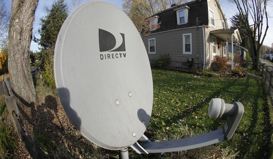 **FILE** This photo made with a fisheye lens on Nov. 2, 2011, shows a DirecTv satellite dish on a post in the front yard of a home in Harmony, Pa.  (AP Photo/Keith Srakocic)