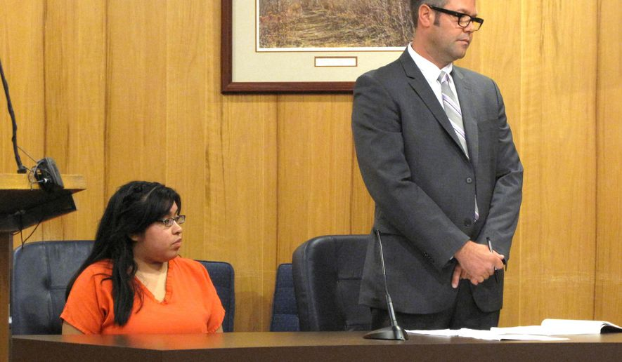 In this photo taken on Tuesday, Sept. 30, 2014, Alyce Morales, left, sits with her attorney Jesse Williams during her sentencing hearing in Beulah, Mich. Morales, who pleaded guilty to manslaughter in the killing of her newborn at a northern Michigan campground, was sentenced to 29 months in prison.  (AP Photo/The Record-Eagle, Matt Troutman) MANDATORY CREDIT (REV-SHARE)