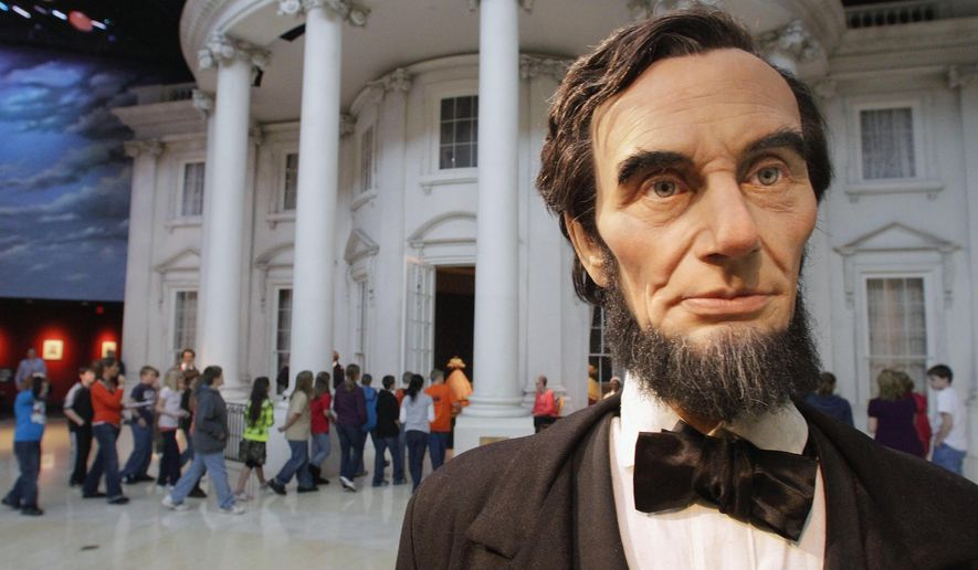 "In this Feb. 10, 2012 file photo, school students enter the ""White House"" as a life-size Abraham Lincoln replica stands outside, while touring the Abraham Lincoln Presidential Library and Museum in Springfield, Ill. The chairman of the foundation behind the Library and Museum says fundraising is drying up because of tensions between library directors and the state agency that oversees it. (AP Photo/Seth Perlman, File)FILE -"