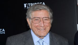 """FILE - In this Feb. 24, 2014 file photo, singer Tony Bennett poses at the 20th anniversary screening of """"A Bronx Tale"""" in New York. The 88-year-old singer has another record for oldest performer with a No. 1 album on the Billboard 200 for """"Cheek to Cheek,"""" his jazz duets collaboration with Lady Gaga. (Photo by Evan Agostini/Invision/AP, File)"""