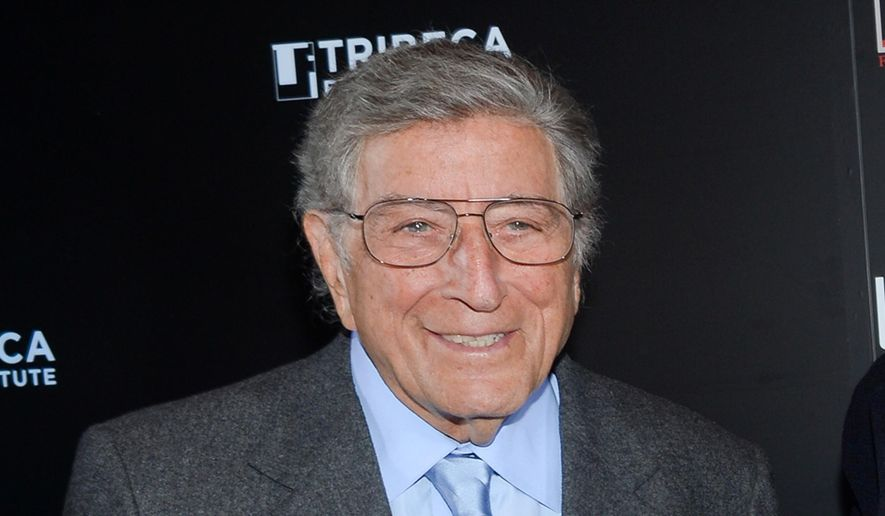 "FILE - In this Feb. 24, 2014 file photo, singer Tony Bennett poses at the 20th anniversary screening of ""A Bronx Tale"" in New York. The 88-year-old singer has another record for oldest performer with a No. 1 album on the Billboard 200 for ""Cheek to Cheek,"" his jazz duets collaboration with Lady Gaga. (Photo by Evan Agostini/Invision/AP, File)"
