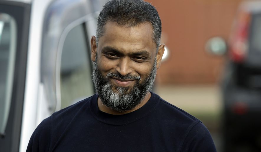 British Moazzam Begg leaves Belmarsh Prison in south London, after his release, Wednesday, Oct. 1, 2014. British prosecutors dropped terrorism charges Wednesday against the former Guantanamo Bay detainee who is a high-profile advocate for the rights of terror suspects. Begg, who has been in prison for seven months awaiting trial, had been due to stand trial next week on seven counts relating to the war in Syria. But in a last-minute reversal, prosecutors acknowledged that new evidence had emerged that undermined the case. (AP Photo/Lefteris Pitarakis)